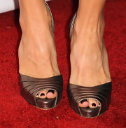Felicity Huffaman's pretty, dark burgundy pedicure paired perfectly with her metallic copper shoes and the 'Desperate Housewives' final season kick-off party