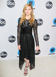 Katherine McNamara sealed off her look with sexy black lace-up heels.
