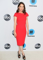 Robin Tunney styled her frock with strappy black platforms.