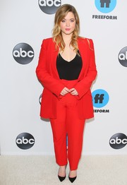 Sasha Pieterse teamed a red Alexander McQueen pantsuit with a low-cut black top for the Disney ABC Television TCA Winter Press Tour.