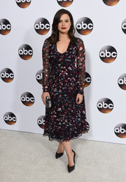 Katie Lowes completed her look with black suede pumps by Loriblu.