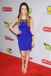Laura Marano kept her red carpet look fun and trendy with a purple peplum dress.