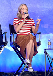Emily Blunt paired a red and white striped knit top with a tan suede skirt, both by Miu Miu, for the 'Mary Poppins Returns' press conference.