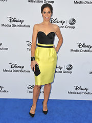 Ana wore this black sweetheart neck corset top with a lovely yellow skirt to the Disney Media Upfronts.