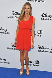 Denise Richards' red dress had a fun and playful look to it with its short but flowing skirt.