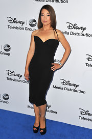 Ming-Na stuck to a strapless structured black dress on the carpet of the Disney Media upfront.