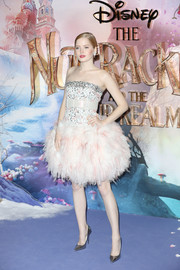 Ellie Bamber paired her charming dress with silver pumps.