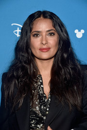 Salma Hayek stuck to her signature long center-parted style at the Disney Studios Showcase Presentation during D23 Expo.