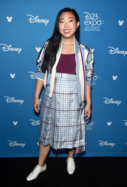 Awkwafina went sporty in a striped bomber jacket by Thom Browne at the Disney Studios Showcase Presentation during D23 Expo.