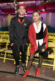 Jamie Chung attended the kickoff of the 'Mickey the True Original' campaign wearing red Veronica Beard ankle boots that were a perfect match to her cardigan.