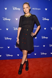 Pom Klementieff chose a black Louis Vuitton mini skirt with gold buttons to complete her outfit.