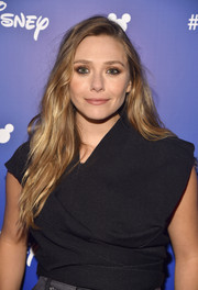 Elizabeth Olsen looked stylish with her loose, messy waves while attending Disney's D23 Expo 2017.