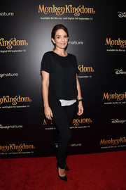 Tina Fey was minimalist-chic on the 'Monkey Kingdom' red carpet in a black Veronica Beard blouse accented with a longer white underlay.