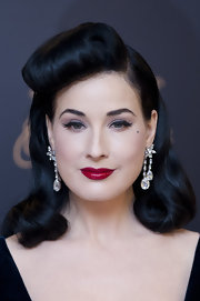 Dita wore her raven locks in genteel waves with a voluminous pinned-back pompadour. at the launch of her new lingerie line.