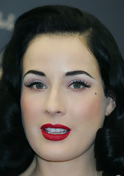 Dita Von Teese attended a photocall for the Von Follies for Target wearing a pair of wispy false lashes.