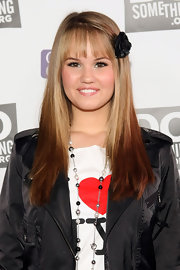 Debby wore a black flower hair pin to accent her sleek straight locks.