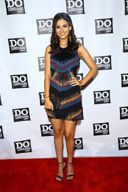 Victoria Justice teamed her sassy dress with simple black ankle-strap sandals by Steve Madden.