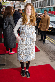 Rose Leslie teamed her coat with a pair of black KG Kurt Geiger oxfords.