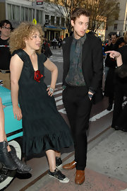 Arthur Darvill rocked a vintage look from head-to-toe, adding a pair of relaxed black slacks.
