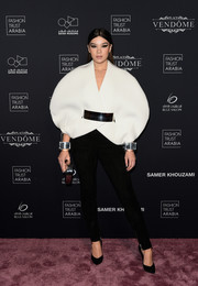 Hailee Steinfeld looked ultra modern in a sculptural white jacket by Balmain at the Fashion Trust Arabia Gala.
