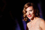Scarlett Johansson's red lips were the center of attention at the Dolce & Gabbana Spring 2012 fashion show in Milan. To try her bold look, we recommend  Covergirl LipPerfection Lipcolor in Hot.