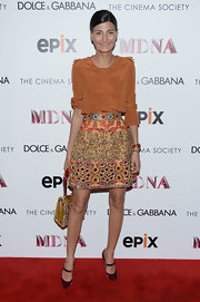 Giovanna Battaglia added a touch of vintage chic to her look with a pair of wine-colored velvet Mary Janes.