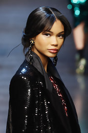Chanel dusted her shoulders off with a pair of black and gold music note earrings for the Dolce and Gabbana fashion show.