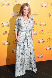 Kylie Minogue looked breezy in a printed maxi shirtdress at the '9 to 5' musical gala.