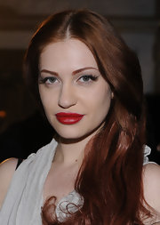 Rich red lips played a dramatic contrast to Porcelain Black's fair complexion.