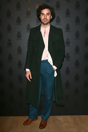 Guido Taroni sported a long green coat for an old-school suave look at Milan Fashion Week.