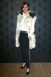 Cristina Parodi paired an over-sized fur vest with skinny pants for a stylish and sophisticated look.