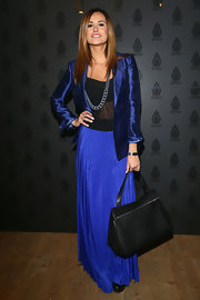 Michela Coppa showed she's not afraid of blue with a royal blue blazer paired with a blue maxi.