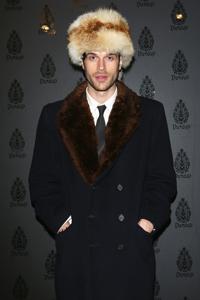 An old-school fur hat is sure to keep Ivan Olita warm from the Milan winter chill.