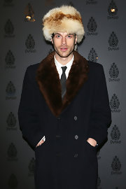 Ivan Olita definitely kept out the winter chill with a fur trimmed wool coat paired with a fur hat at Milan fashion week.