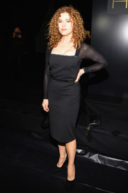 Bernadette Peters oozed classic elegance in a little black dress with a square neckline and sheer sleeves during the DKNY 30th anniversary fashion show.