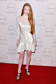 Larsen Thompson attended the Dove Cameron x Bellami launch wearing a little white slip dress over a matching sheer turtleneck.