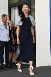 Hong Chau attended the Venice Film Festival photocall for 'Downsizing' wearing a navy Ferragamo midi dress with contrasting puffed sleeves.