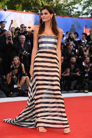 Isabeli Fontana hit the Venice Film Festival opening ceremony wearing a striped, strapless Alberta Ferretti gown with a glittery bodice and a sheer skirt.