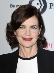 Elizabeth McGovern wore a short side-parted 'do with curly ends during the 'Downton Abbey' cast photocall.