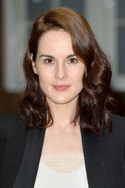 Michelle Dockery styled her shoulder-length locks with bouncy curls for the 'Downton Abbey' press launch.