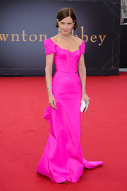 Elizabeth McGovern was impossible to miss in this elegant hot-pink off-the-shoulder gown by Zac Posen at the world premiere of 'Downton Abbey.'