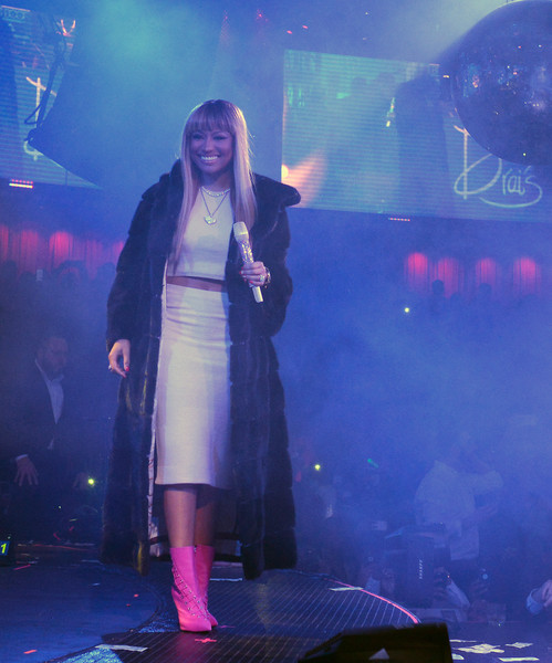 Nicki Minaj's hot-pink lace-up boots totally popped against her neutral outfit.