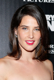 Cobie Smulders added rich color with a swipe of red lipstick.