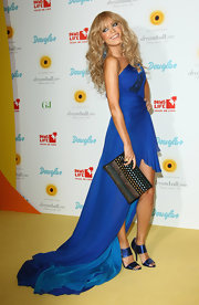 Sylvie van der Vaart posed with her black studded clutch that glimmered with an array of bright colors.