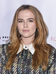 Zoey Deutch wore her tresses down in a tousled, center-parted style at the Shop for Success VIP event.