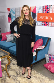 Drew Barrymore kept it modest in a long-sleeve lace-panel midi dress at the Shutterfly Holiday Gift Collection launch.