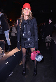 Anna dello Russo wore an edgy-stylish black military jacket sans pants during the Dsquared2 fashion show.