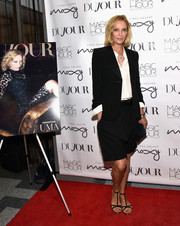 Uma Thurman kept her feet comfy in flat T-strap sandals.