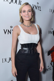 Diane Kruger attended her DuJour cover celebration flaunting an impossibly tiny waist accented with a Mugler corset belt.
