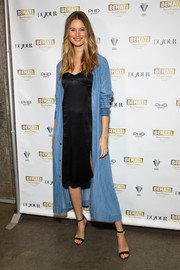 Behati Prinsloo proudly showed off a stylish denim duster coat from her Juicy Couture collection.